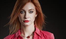 Portrait of beautiful redhead woman. Stock Photos