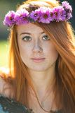 Portrait of a beautiful redheaded freckled woman. With a wreath Royalty Free Stock Image