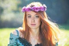 Portrait of a beautiful redheaded freckled woman. With a wreath Stock Photos
