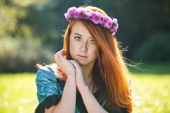 Portrait of a beautiful redheaded freckled woman. With a wreath Stock Images