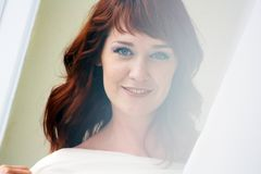 Portrait of a beautiful redheaded woman looking flirtatious. Closeup Stock Images