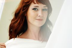 Portrait of a beautiful redheaded woman looking flirtatious. Closeup Royalty Free Stock Images