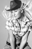 Portrait of beautiful rodeo girl in cowboy hat Stock Photo