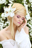 Portrait of Beautiful romantic woman with flower. Portrait of the Beautiful romantic woman with flower. sensual touch Royalty Free Stock Photography