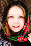 Portrait of beautiful russian girl in a shawl Stock Images