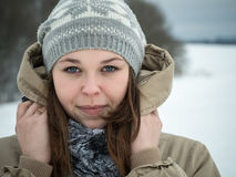 Portrait of a beautiful Russian girl in winter outdoors stock image