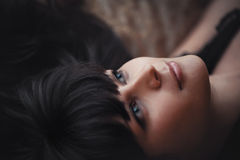 Portrait of a beautiful sad brunette girl closeup Stock Images