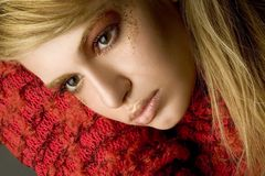 Portrait of a beautiful sad girl in red sweater Royalty Free Stock Image