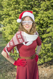 Portrait of a beautiful Santa Claus girl with party glasses Stock Photography