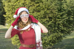 Portrait of a beautiful Santa Claus girl with party glasses Stock Photo