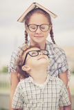 Portrait of Beautiful school boy and girl looking very happy out Stock Photography
