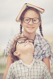 Portrait of Beautiful school boy and girl looking very happy out Stock Images