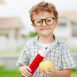 Portrait of Beautiful school boy looking very happy outdoors at Royalty Free Stock Photo