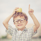 Portrait of Beautiful school boy looking very happy outdoors at Royalty Free Stock Photos