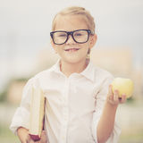 Portrait of Beautiful school girl looking very happy outdoors at Royalty Free Stock Photo