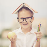 Portrait of Beautiful school girl looking very happy outdoors at Stock Photography