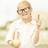 Portrait of Beautiful school girl looking very happy outdoors at Royalty Free Stock Images