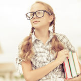 Portrait of Beautiful school girl looking very happy outdoors at Stock Image