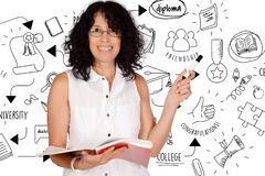 Portrait of beautiful school teacher drawing graduation sketch. royalty free stock photography