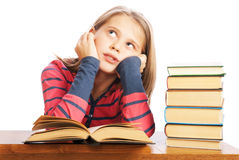 Portrait of a beautiful schoolgirl reading a book Royalty Free Stock Photos
