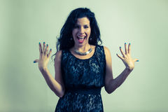 Portrait of a beautiful screaming brunette Stock Photography