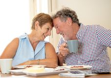 Portrait of a beautiful senior couple having breakfast together. Portrait of a attractive mature retired couple having breakfast together at home enjoying the Stock Images
