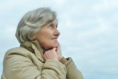 Beautiful senior woman against blue sky. Portrait of beautiful senior woman against blue sky Royalty Free Stock Photography