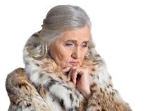 Portrait of beautiful senior woman in fur coat royalty free stock images