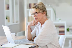 Portrait of beautiful senior woman on laptop Royalty Free Stock Image