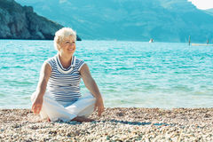 Portrait of beautiful senior woman on the seaside Stock Image
