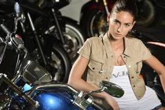 Portrait of beautiful sensitive woman with motorcycle Royalty Free Stock Image