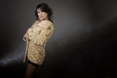 Portrait of the beautiful, sensory. Beautiful sensory woman on the dark background Royalty Free Stock Photography
