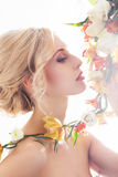 Portrait of a beautiful, sensual bride with flowers Royalty Free Stock Photos