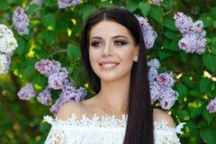 Portrait of beautiful sensual brunette girl in white dress in li Royalty Free Stock Photography