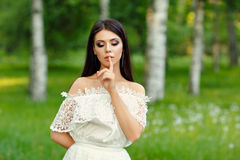 Portrait of beautiful sensual brunette girl in white dress, put Stock Photos