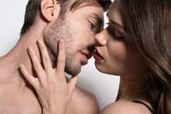 Portrait of beautiful sensual couple embracing and kissing. On white royalty free stock photography