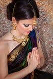 Portrait of beautiful sensual girl in indian sari. Beautiful girl with oriental make-up, indian sari and indian jewelry Stock Photos