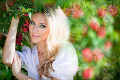 Portrait of a beautiful sensual and blonde girl on the back stock image