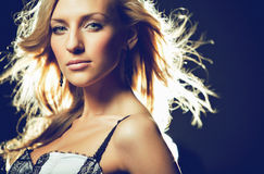 Portrait of a beautiful sensual and sexy blonde girl with flying Royalty Free Stock Images