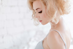 Portrait of a beautiful sensual and blonde girl on white ba. Ckground, close-up stock photos