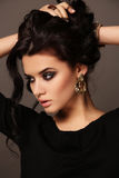 Portrait of beautiful sensual woman with dark hair with bijou Stock Photography