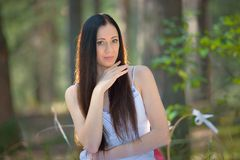 Portrait of beautiful sensual woman in forest Royalty Free Stock Photography