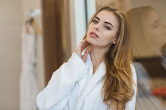 Portrait of beautiful sensual young blonde woman in bathrobe Stock Images