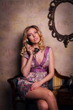 Portrait of beautiful sensual young lady with stylish phone Royalty Free Stock Image