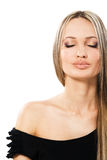 Portrait of beautiful serene woman. Against white background Royalty Free Stock Images