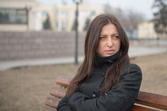 Portrait of beautiful serious woman outdoors Stock Image