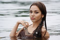 Portrait beautiful and sexual girl in river Stock Photo