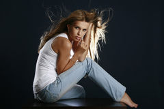 Portrait of the beautiful sexual woman. On dark-blue background royalty free stock photo
