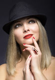 Portrait of the beautiful sexy blonde woman with red lips in mod Stock Photo
