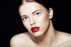 Portrait of a beautiful sexy brunette girl. With red lips Stock Images